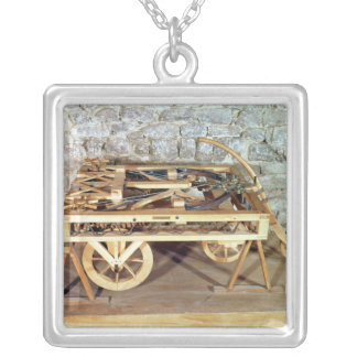 Model of a car driven by springs silver plated necklace