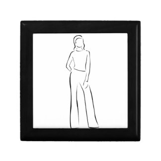 Model on a runway in designer outfit small square gift box