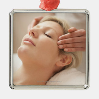 MODEL RELEASED. Facial. Christmas Ornament