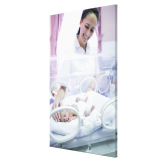 MODEL RELEASED. Nurse and premature baby. Canvas Print