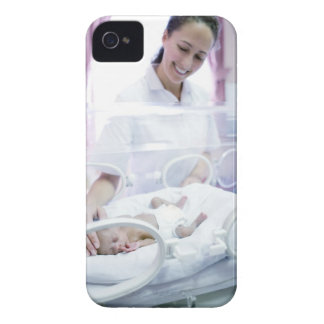 MODEL RELEASED. Nurse and premature baby. Case-Mate iPhone 4 Case