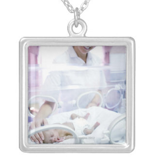 MODEL RELEASED. Nurse and premature baby. Silver Plated Necklace