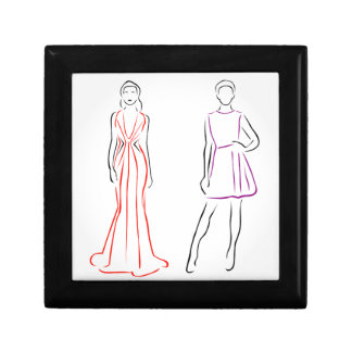 Models in designer outfits small square gift box
