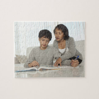 mom helping son with homework puzzle