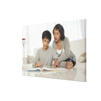 mom helping son with homework stretched canvas prints