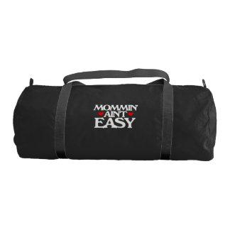 Mommin' ain't easy gym duffel bag