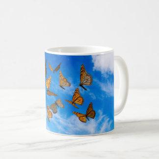 Monarch butterflies in the sky coffee mug