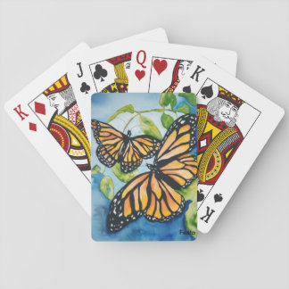 Monarch butterflies playing cards
