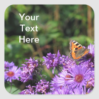 Monarch butterfly and purple flowers square sticker