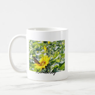 Monarch butterfly on sunflower coffee mug