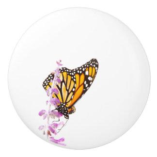 Monarch perched on lavender ceramic knob