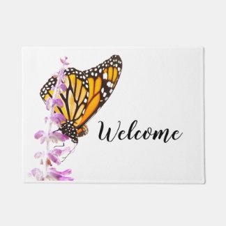 Monarch perched on lavender doormat