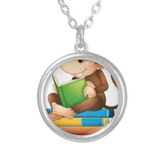 Monkey and books round pendant necklace