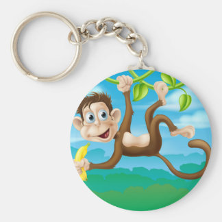 Monkey cartoon in jungle swinging on vine keychain