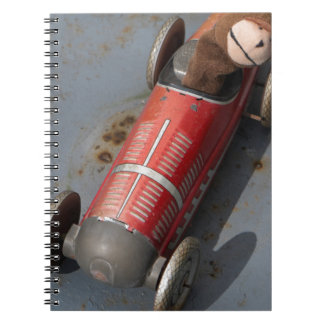 Monkey in a toy car notebooks