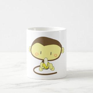 Monkey peeling a banana coffee mug