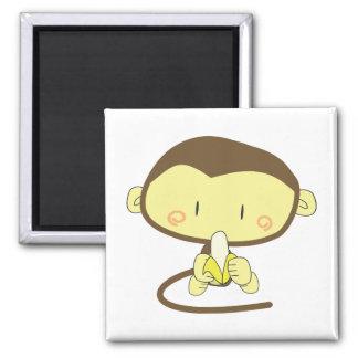 Monkey peeling a banana magnets