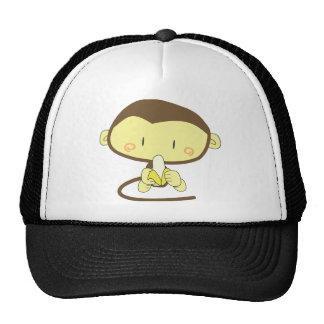 Monkey peeling a banana mesh hats
