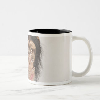 Monkey rubbing its face Two-Tone coffee mug