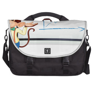 monkey showing white board computer bag