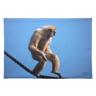 Monkey walking on rope placemat