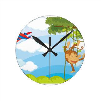 monkeys round wall clocks