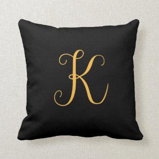 "Monogram gold-colored ""K"" on black Throw Pillow"