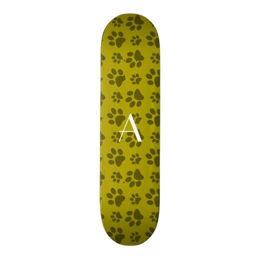 Monogram mustard yellow dog paw prints skate decks