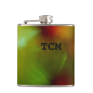 Monogram on abstract marble green and red flasks