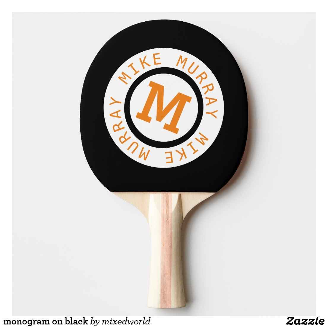 monogram on black ping pong paddle