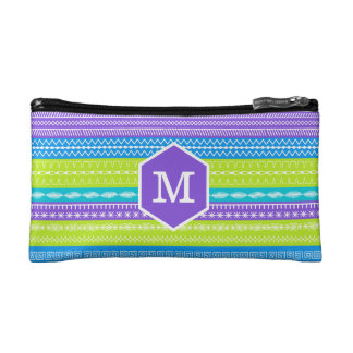 Monogram on bright peacock colored stitches cosmetics bags
