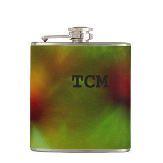 Monogram on green and red flask