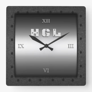 Monogram on shiny steel-effect with riveted frame clocks