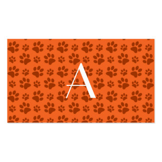 Monogram orange dog paw prints business card template