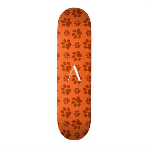 Monogram orange dog paw prints skate board deck