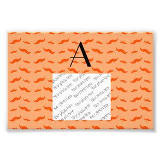 Monogram pastel orange mustache pattern photograph