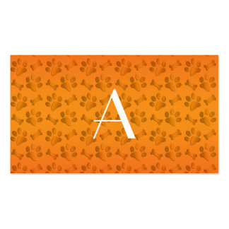 Monogram shiny orange dog paw prints business card