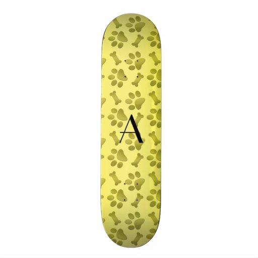 Monogram shiny yellow dog paw prints skateboards