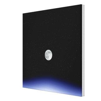 Moon rise over Earth Canvas Print