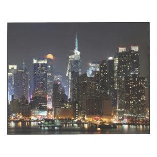 Moon rises over midtown New York.
