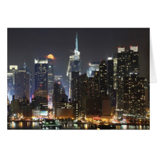 Moon rises over midtown New York. Card