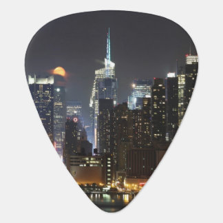 Moon rises over midtown New York. Guitar Pick