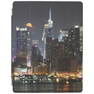 Moon rises over midtown New York. iPad Cover