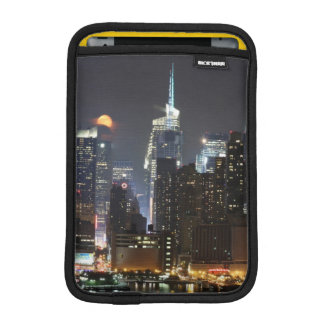 Moon rises over midtown New York. iPad Mini Sleeve