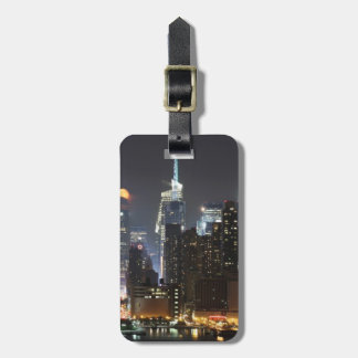 Moon rises over midtown New York. Luggage Tag