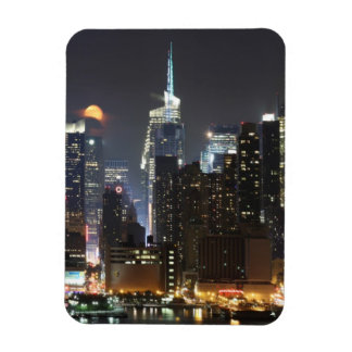 Moon rises over midtown New York. Magnet