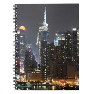 Moon rises over midtown New York. Notebooks