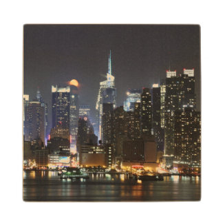 Moon rises over midtown New York. Wood Coaster