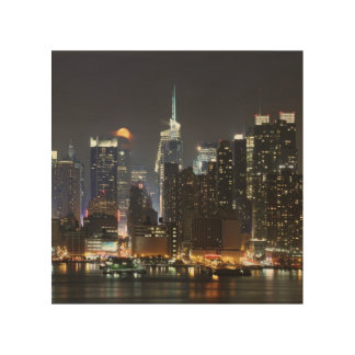 Moon rises over midtown New York. Wood Print