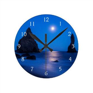 Moonrise reflection on ocean and sea stacks clocks